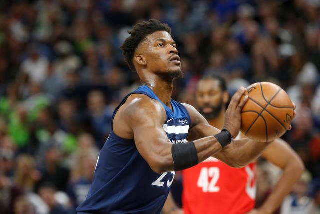 FILE - In this April 21, 2018, file photo, Minnesota Timberwolves' Jimmy Butler plays against the Houston Rockets in the first half during Game 3 of an NBA basketball first round playoff series in Minneapolis. With Butler's trade demand swirling like a dark cloud around coach Tom Thibodeau, newly minted super-max player Karl-Anthony Towns and the Timberwolves arrive for training camp. (AP Photo/Jim Mone, File)