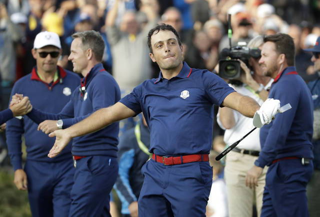 Europe's Francesco Molinari celebrates after winning a foursome match with his partner Tommy Fleetwood on the opening day of the 42nd Ryder Cup at Le Golf National in Saint-Quentin-en-Yvelines, outside Paris, France, Friday, Sept. 28, 2018. Molinari and Fleetwood beat Justin Thomas of the US and Jordan Spieth 5 and 4. (AP Photo/Matt Dunham)