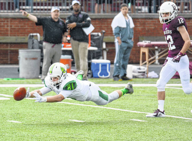 Wilmington College receiver AJ Hightower goes all-out to make a catch during the Sept. 1 game against Earlham. WC won the game 49-7.