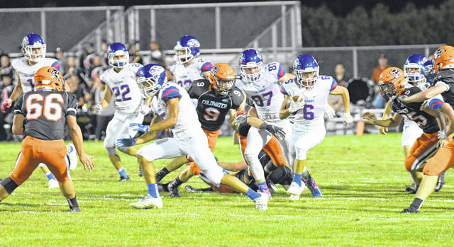Clinton-Massie's Carson Vanhoose (6) finds an opening against Coldwater in a Week 2 game.