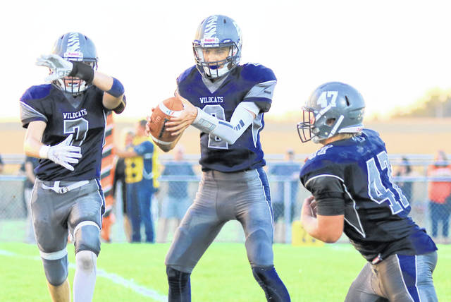 Blanchester quarterback Brayden Sippled (2) works a little handoff magic with Tanner Creager (7) and James Peters (47) during Friday night's game against Wilmington.