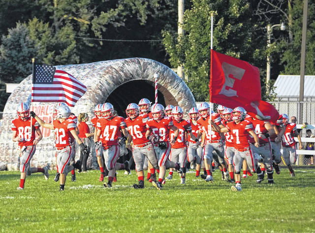 On Military Appreciation Night, the East Clinton football team enters the field for the game against McClain at ECHS.