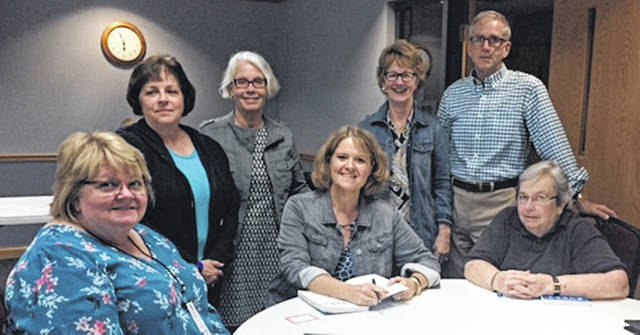 Foster children advocate Holly Schlaack, seated in the middle, is pictured with Clinton County CASA volunteers. The CASA volunteers are, from left seated, Diana Groves and Kenna Edwards; and, from left standing, are Kathy Vincent, Lorry Swindler, Clinton County CASA Director Kim Vandervort with the Juvenile Court, and Kent Vandervort.