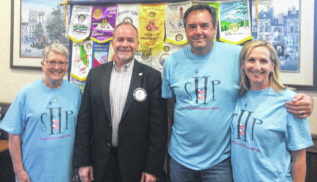 From left are: Carolyn Simpson, Sleep in Heavenly Peace volunteer; Dan Evers, President of the Wilmington Rotary Club; and Mike Watkins and Eileen Watkins, organizers of the Butler County Chapter of the Sleep in Heavenly Peace organization.