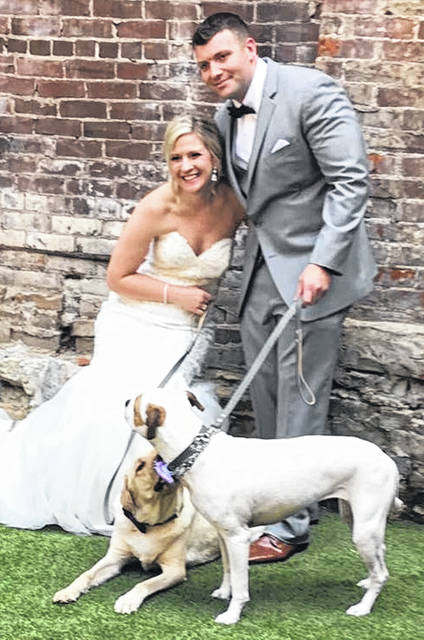 Kari and Adam Burris — who met at a dog park! — share their wedding day with Louie and Gemma.