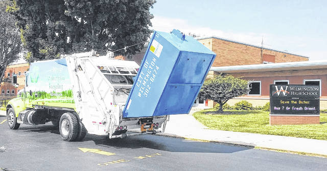 Wilmington High School receives its cardboard dumpster for recycling.