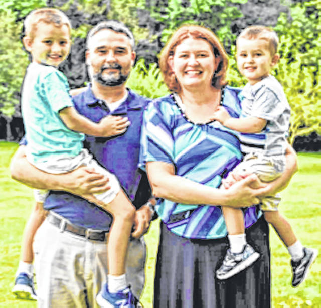 New Clinton-Massie Local School District Treasurer Carrie Bir with her husband, Justin, a mechanical engineer, and their sons Isaac and Henry.