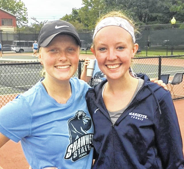 Clinton-Massie graduates Claire Carruthers (left) and Anne Thompson (right) faced each other at Marietta College in a tennis match.