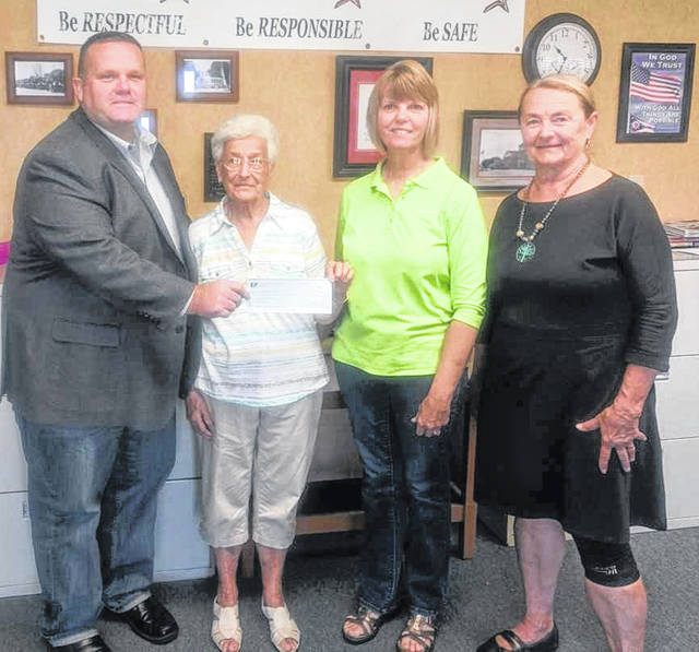 """At the Ohio District Kiwanis Convention, the Kiwanis Club of Wilmington was awarded a grant from the Ohio District Foundation to assist in purchasing """"buddy benches"""" at two elementary buildings for Wilmington City Schools and the Sabina and New Vienna Elementary buildings for the East Clinton School District. They will be placed in the playgrounds for children having a bad day and needing someone to play with. When seeing someone on the bench, all children will understand this as a signal that the child needs a playmate. Shown accepting a check is East Clinton Superintendent Eric Magee with, from left, Kiwanians Ruth Curtis, Kim Hiatt and Terri Thobaben."""