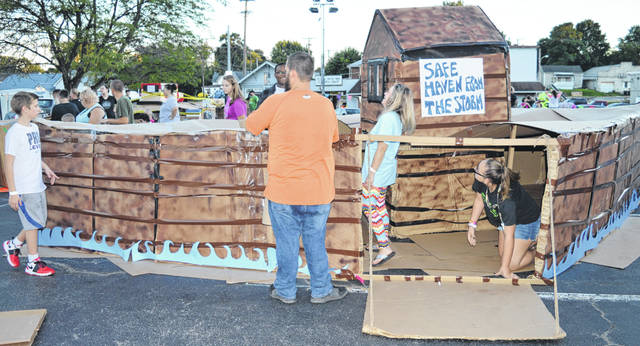 A group of young people and some adults from the Wilmington Church of God off Nelson Avenue constructed a cardboard version of Noah's ark for the Cardboard City fundraiser Saturday night. A week earlier the youth held a hot dog fundraiser and fed the congregation, raising nearly $1,000 for the homeless shelter.