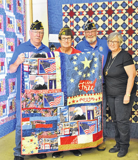 The Clinton County Quilt Guild donated two Honor Quilts to the Wilmington veterans organizations. Julie Jennings presented the quilts on behalf of the Quilters Guild. Accepting for Wilmington American Legion Post 49 are 1st Vice Commander Richard James and Adjutant Brady Stevens. Accepting for the Wilmington Veterans of Foreign Wars Post 6710 is Service Officer Leslie Rose.