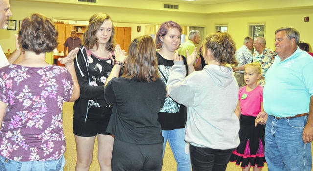 There's something of a youth movement at the local square-dancing club — named the Clinton County Country Squares — as seen in this Sept. 6 photograph.