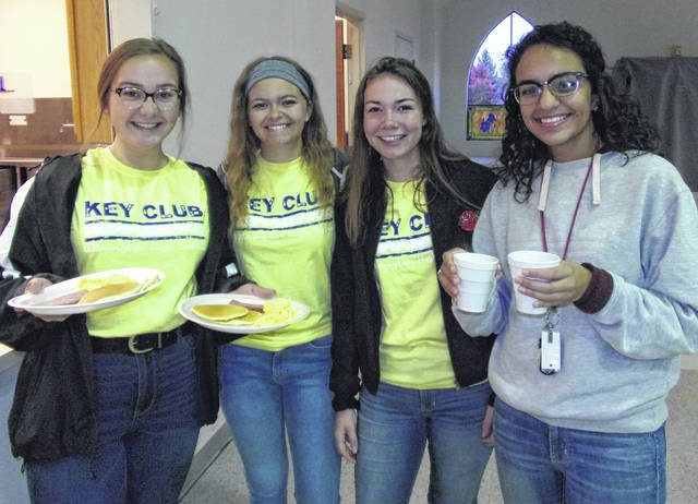 Wilmington High School Key Club members Regan Sparks, Paiton Walker, Shelby Robertson and Key Club President Zane Beekheet serving pancakes, coffee and juice to attendees.