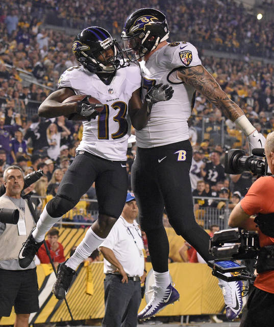 Baltimore Ravens wide receiver John Brown (13) celebrates with Maxx Williams after a 33 yard touchdown reception in the first half of an NFL football game against the Pittsburgh Steelers in Pittsburgh, Sunday, Sept. 30, 2018. (AP Photo/Don Wright)