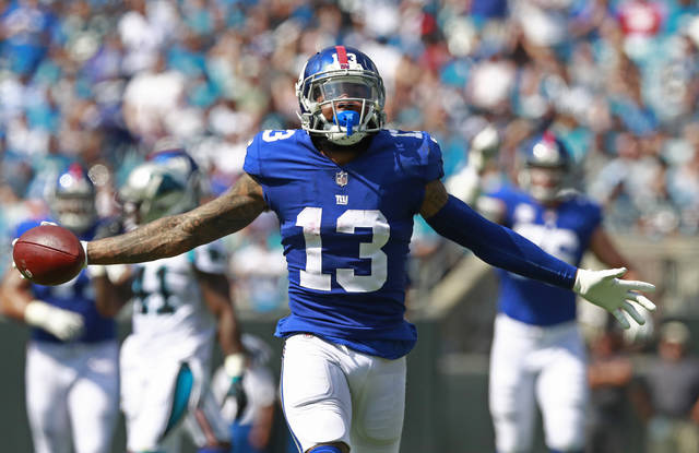 New York Giants' Odell Beckham (13) celebrates a catch against the Carolina Panthers in the first half of an NFL football game in Charlotte, N.C., Sunday, Oct. 7, 2018. (AP Photo/Jason E. Miczek)