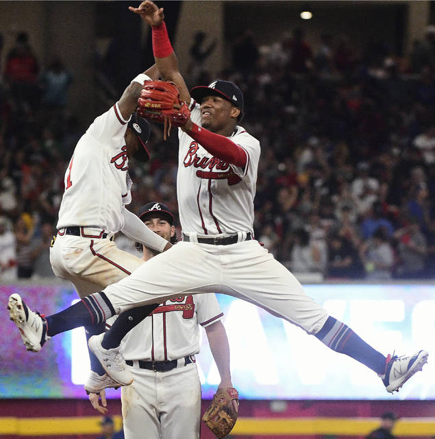 Atlanta Braves left fielder Ronald Acuna Jr. (13) celebrates the team's victory over the Los Angeles Dodgers after the ninth inning in Game 3 of MLB baseball's National League Division Series, Sunday, Oct. 7, 2018, in Atlanta. The Atlanta Braves won 6-5. (AP Photo/John Amis)