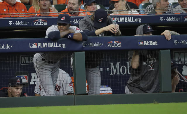FILE - In this Oct. 5, 2018, file photo, Cleveland Indians players watch from the dugout during the ninth inning  of their 7-2 loss in Game 1 of an American League Division Series baseball game against the Houston Astros, in Houston. For the third year in a row, the unmistakable aroma of champagne filled the visitor's clubhouse after the final game at Progressive Field. (AP Photo/David J. Phillip, File)