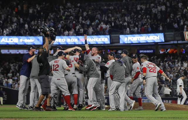 The Boston Red Sox celebrate after beating the New York Yankees 4-3 in Game 4 of baseball's American League Division Series, Tuesday, Oct. 9, 2018, in New York. (AP Photo/Julie Jacobson)