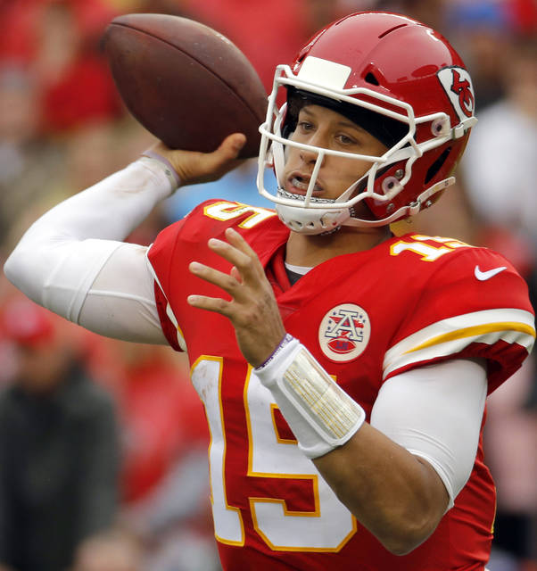 FILE - In this Oct. 7, 2018, file photo, Kansas City Chiefs quarterback Patrick Mahomes (15) throws a pass during the first half of an NFL football game against the Jacksonville Jaguars, in Kansas City, Mo. New England Patriots' Tom Brady, who will retire as possibly the best to ever play the position, faces Kansas City's Patrick Mahomes, the most electrifying quarterback in the NFL this season, on Sunday.  (AP Photo/Charlie Riedel, File)