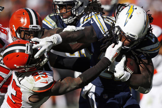 Cleveland Browns defensive back Damarious Randall (23) attempts to tackle Los Angeles Chargers running back Melvin Gordon (28) in the second half during an NFL football game, Sunday, Oct. 14, 2018, in Cleveland. (AP Photo/Ron Schwane)