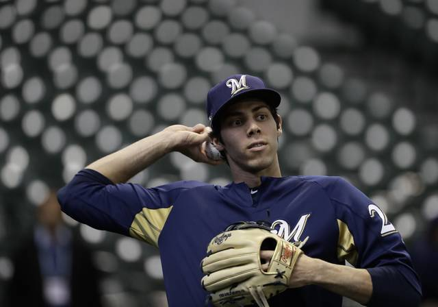 Milwaukee Brewers' Christian Yelich warms up before Game 1 of the National League Championship Series baseball game against the Los Angeles Dodgers Friday, Oct. 12, 2018, in Milwaukee. (AP Photo/Matt Slocum)