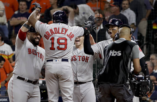 Boston Red Sox's Jackie Bradley Jr. celebrates after his grand slam against the Houston Astros during the eighth inning in Game 3 of a baseball American League Championship Series on Tuesday, Oct. 16, 2018, in Houston. (AP Photo/David J. Phillip)