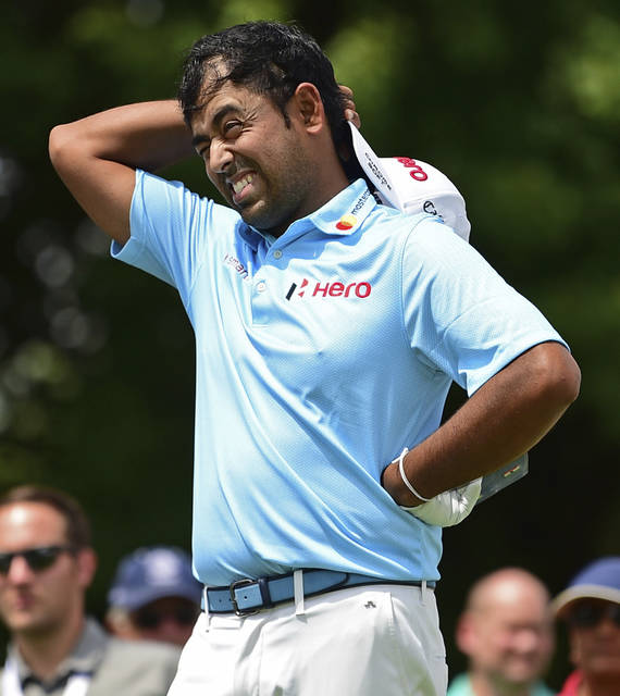 FILE - In this Aug. 2, 2018, file photo, Anirban Lahiri, from India, reacts after his tee shot on the 17th hole during the first round of the Bridgestone Invitational golf tournament at Firestone Country Club, in Akron, Ohio. The strength of field for the CIMB Classic was the same as it was last year, with one exception that Anirban Lahiri nearly found out the hard way. Lahiri had gone to Malaysia the previous five years and he noted that the field _ which the top 60 players available from the FedEx Cup _ had always gone below 100. Lahiri finished last year at No. 99 and figured there was nothing to worry about. And then there was. (AP Photo/David Dermer, File)
