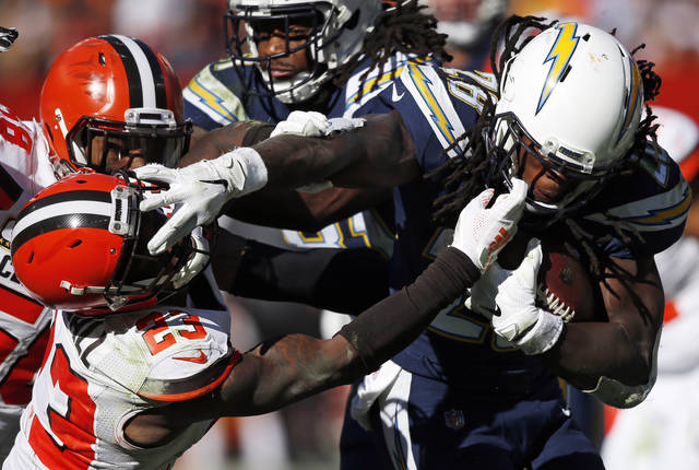 FILE - In this Oct. 14, 2018 file photo Cleveland Browns defensive back Damarious Randall (23) attempts to tackle Los Angeles Chargers running back Melvin Gordon (28) in the second half of an NFL football game in Cleveland. The Browns have endured all types of losses over the past few seasons. After being so competitive through their first five games, the Browns (2-3-1) were simply overmatched by the Chargers, who rushed for 246 yards, contained and confused rookie quarterback Baker Mayfield and wrecked a picture-perfect day near Lake Erie for Cleveland fans hoping to see their team win two straight home games for the first time in four years. (AP Photo/Ron Schwane)