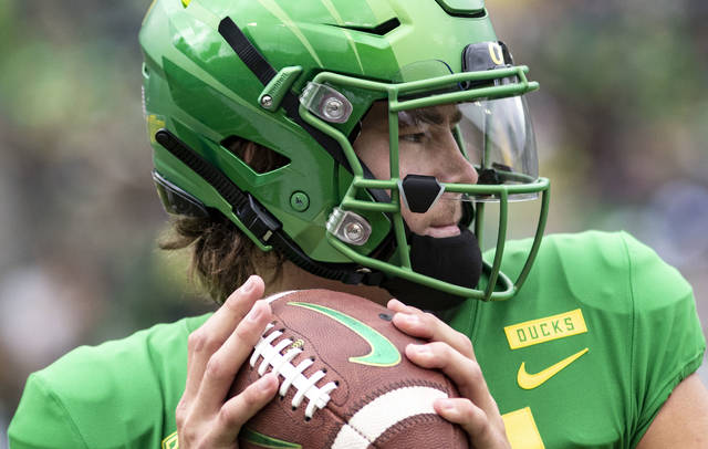 FILE - In this Saturday, Sept. 8, 2018, file photo, Oregon quarterback Justin Herbert went 20-of-26 with 250 yards, four touchdowns and no picks in their 62-14 win against Portland State during an NCAA college football game in Eugene, Ore. The front-runners have clearly been established in the Heisman race, but the question now is who else can emerge with a late rush? (AP Photo/Thomas Boyd, file)