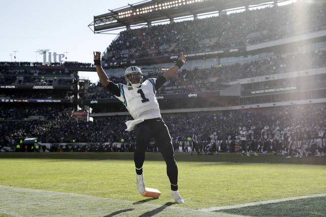 Carolina Panthers quarterback Cam Newton trips over the pylon while celebrating after throwing a touchdown pass to tight end Greg Olsen during the second half of an NFL football game against the Philadelphia Eagles, Sunday, Oct. 21, 2018, in Philadelphia. (AP Photo/Matt Rourke)