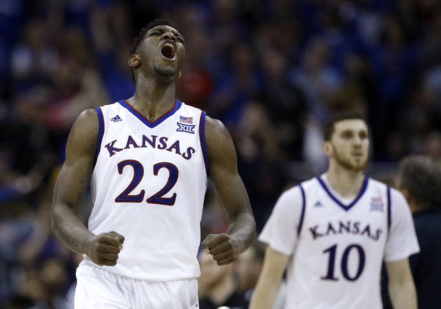 FILE - In this March 10, 2018, file photo, Kansas' Silvio De Sousa (22) celebrates during the second half of the NCAA college basketball championship game against West Virginia in the Big 12 men's tournament, in Kansas City, Mo. Kansas is ranked No. 1 in The Associated Press preseason Top 25 poll released Monday, Oct. 22, 2018.  (AP Photo/Charlie Riedel, File)