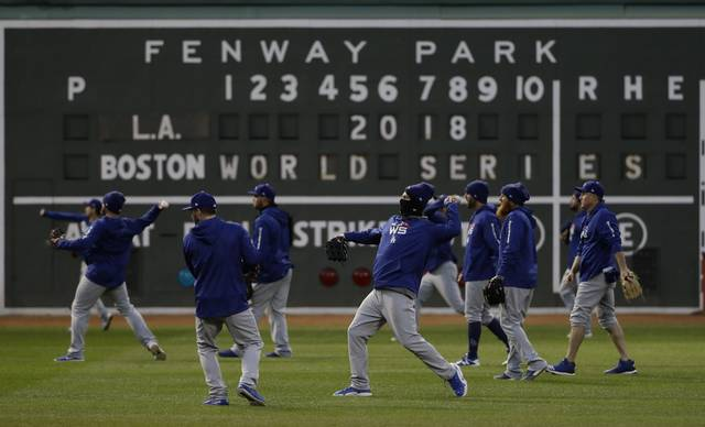 Los Angeles Dodgers' players practice for Game 1 of the World Series baseball game against the Boston Red Sox Monday, Oct. 22, 2018, in Boston. (AP Photo/Matt Slocum)