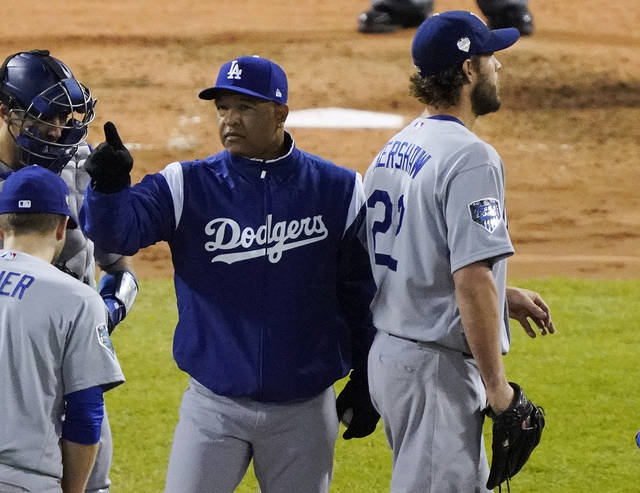 Los Angeles Dodgers manager Dave Roberts calls for a relief pitcher as starter Clayton Kershaw departs during the fifth inning of Game 1 of the World Series baseball game against the Boston Red Sox Tuesday, Oct. 23, 2018, in Boston. (AP Photo/Elise Amendola)