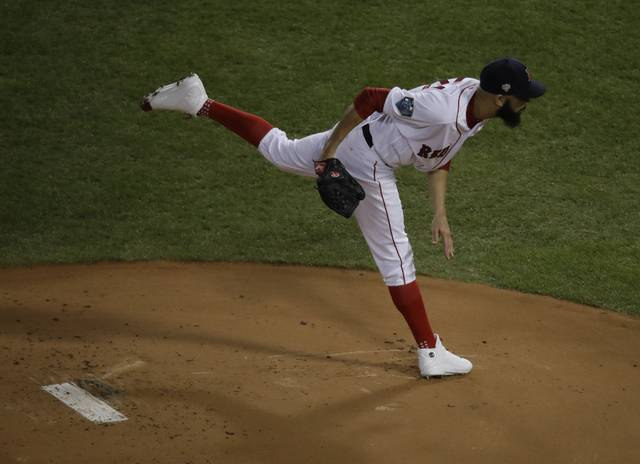 Boston Red Sox starting pitcher David Price throws during the first inning of Game 2 of the World Series baseball game against the Los Angeles Dodgers Wednesday, Oct. 24, 2018, in Boston. (AP Photo/Charles Krupa)