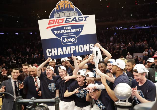 FILE - In this March 10, 2018, file photo, Villanova celebrates after defeating Providence 76-66 in overtime in an NCAA college basketball game in the Big East men's tournament final, in New York. NCAA champion Villanova has been picked by coaches to win the Big East Conference. This is the fifth straight year the Wildcats have held the top spot. They received eight first-place votes Thursday, Oct. 25, 2018, while Marquette and Butler each received one No. 1 pick. (AP Photo/Frank Franklin II, File)