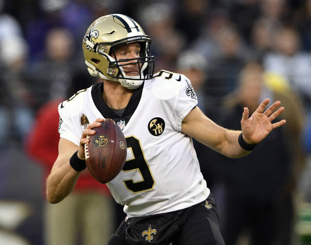 FILE - In this Oct. 21, 2018, file photo, New Orleans Saints quarterback Drew Brees looks for a receiver in the second half of an NFL football game against the Baltimore Ravens, in Baltimore. The Saints play at the Minnesota Vikings on Sunday, Oct. 28. (AP Photo/Nick Wass, File)