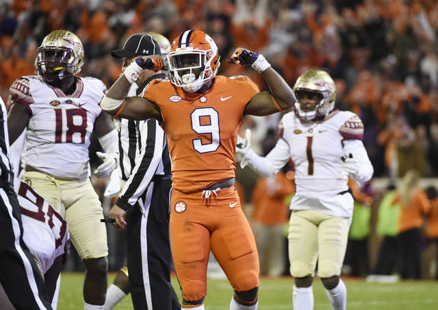 FILE - In this Nov. 11, 2017, file photo, Clemson running back Travis Etienne (9) celebrates after scoring a touchdown, which was called back, during the second half of an NCAA college football game against Florida State, in Clemson, S.C. Clemson is attempting to become the first team to beat Florida State in Atlantic Coast Conference play in four straight seasons. (AP Photo/Rainier Ehrhardt, File)