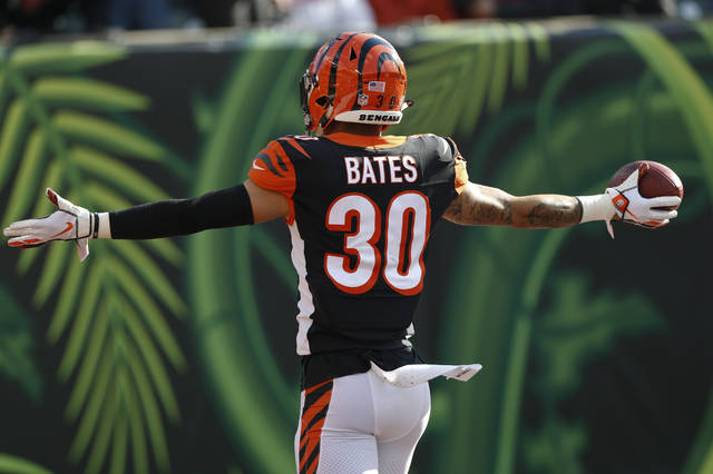 Cincinnati Bengals free safety Jessie Bates (30) celebrates a touchdown on an interception against the Tampa Bay Buccaneers during the second half of an NFL football game in Cincinnati, Sunday, Oct. 28, 2018. (AP Photo/Gary Landers)