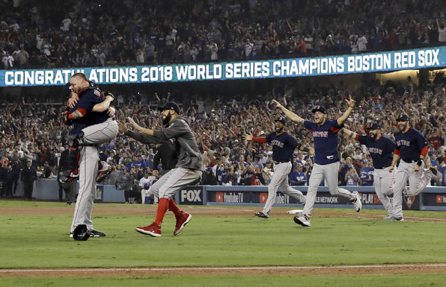 The Boston Red Sox celebrate after Game 5 of baseball's World Series against the Los Angeles Dodgers on Sunday, Oct. 28, 2018, in Los Angeles. The Red Sox won 5-1 to win the series 4 games to 1. (AP Photo/David J. Phillip)