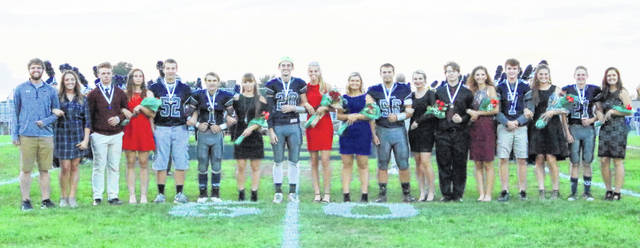 Olivia Gundler was crowned queen and Clayton Schirmer was crowned king Friday at the Blanchester High School Homecoming at Barbour Memorial Field. From left are king Brant Bandow, queen Kayla Cottle, Cole Ficke, Becca Kratzer, Matthew Grogg, Brent Hopkins, Elecia Patton, Schirmer, Gundler, Jordan Fischer, Cody McCollister, Cora Shattuck, Andrew Holland, Lydia Faulkner, Tanner Creager, Brianna Haun, Bryan Bandow, and Madison Creager.