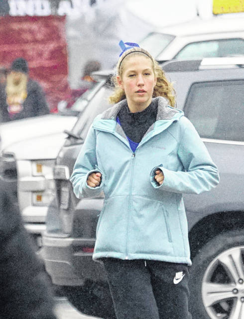 Clinton-Massie's Emma Muterspaw, shown here warming up on the dreary day, was 42nd in the Division II girls race at the Troy Regional Cross Country Championships Saturday.