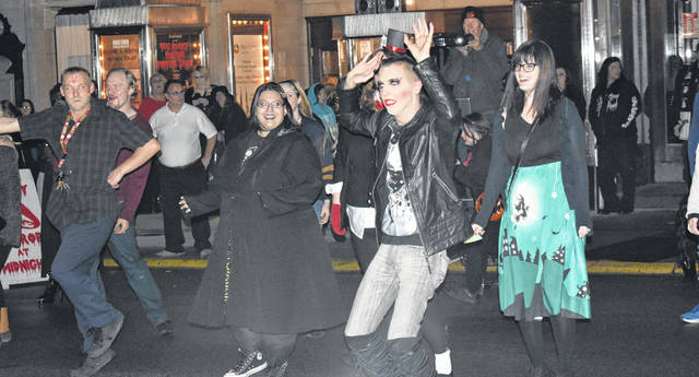 "Locals and visitors did the Time Warp again on Main Street outside the Murphy Theatre on Saturday before the midnight ""Rocky Horror Picture Show"" screening inside the theatre."