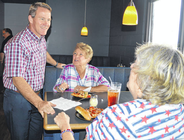 Jon Husted, standing at left, was in Wilmington at lunchtime Thursday for a meet-and-greet at Generations Pizzeria. Ohio Secretary of State Husted is Republican gubernatorial candidate Mike DeWine's running mate for lieutenant governor.