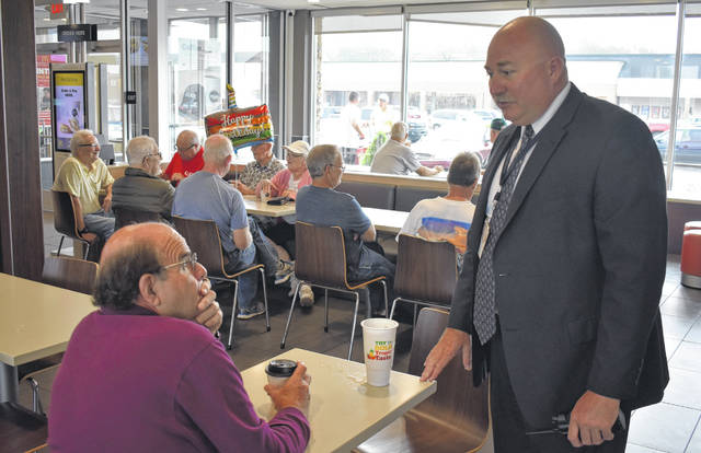 Denny Gherman, left, chats with Wilmington Police Chief Duane Weyand during Coffee with a Cop at McDonald's on Wednesday.