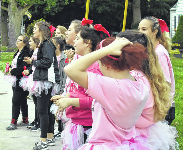 East Clinton High School cheerleaders get ready to cheer as part of their participation in Brake for Breakfast at the Foster J. Boyd Regional Cancer Center Thursday morning.