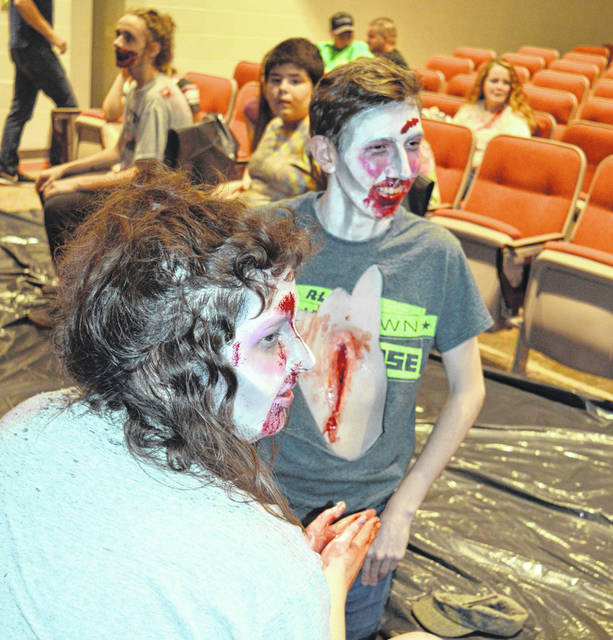 In the left foreground, Aubrey Wile is about done transforming Owen Oflaherty, center foreground, into a zombie character. It was all part of the Laurel Oaks Fall Fest in Wilmington.