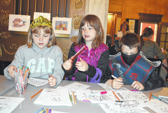 Coloring was a popular activity Saturday at the Halloween Hoopla held in the Murphy Theatre and sponsored by Main Street Wilmington. Though this photo does not show it, there were adults coloring as well.