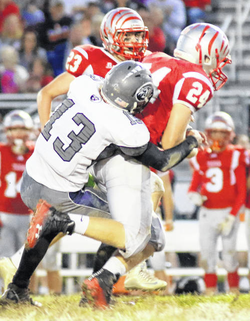 Blanchester's Junior Torres (13) brings down a Bethel-Tate ballcarrier during Friday night's game.