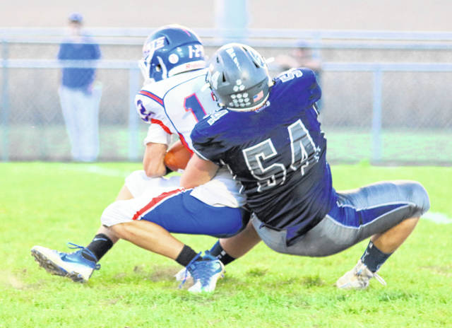 Christian Stubbs (54) brings down a Williamsburg ball carrier during last week's game.