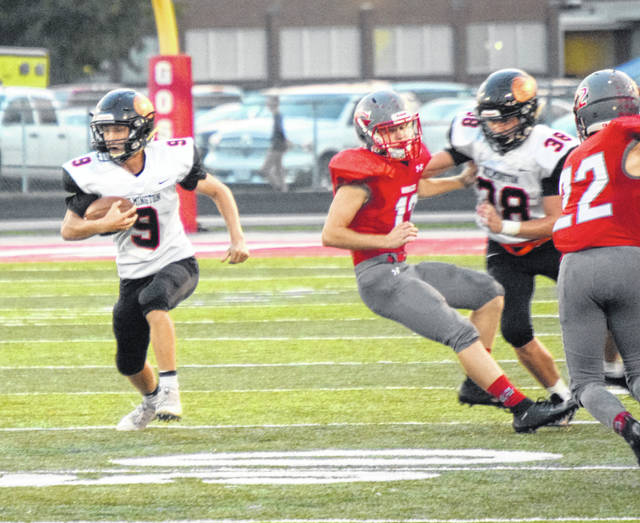 <ol><li>Mason McIntosh (9) looks for running room Friday night against Goshen. McIntosh finished with 16 receptions for 216 yards for the Hurricane. </li></ol>